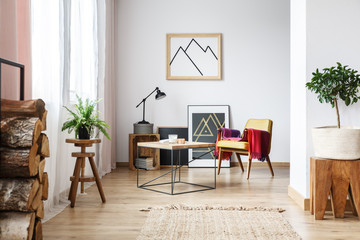 Armchair, minimalist poster and firewood