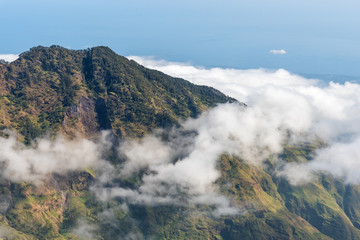 Mountain with Low altitude clouds above. Rinjani mountain, Lombok, Indonesia.