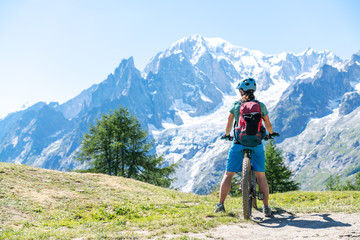 woman Mountain Biking near Mont Blanc, Cormayeur, Val d'Aosta, Italy