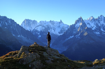 Fotomurales - Man looking at the mountains near Chamonix, France.
