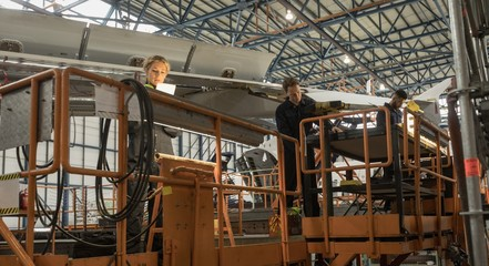 Aircraft maintenance engineers working on aircraft maintenance