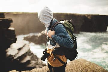 Traveler with photo camera on nature