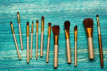 Brush for makeup on a wooden background. Flat lay