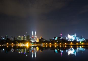 Kuala Lumpur skyline at night time as seen from Taman Tasik Titiwangsa also known as Titiwangsa Lake Garden located in Kuala Lumpur, Malaysia.