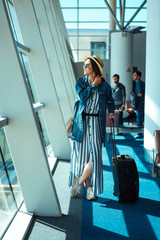 Woman go travel with suit case at airport