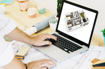 architect working with laptop cad