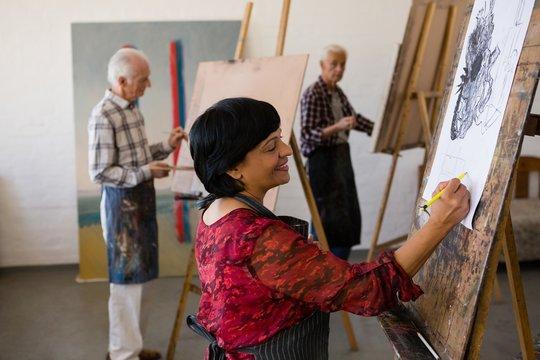 Man and women painting in art studio