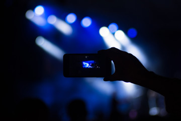 using phone on concert