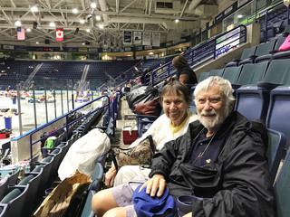Judith and Howard Mayer (R), wait to hear if it's safe to travel back to their home on Sanibel Island from the shelter in Germain Arena in Estero