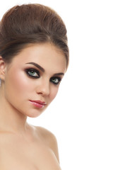 Portrait of young beautiful woman with smoky eyes and hair bun over white background, copy space