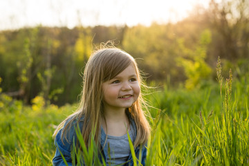 Portrait of girl in field, close up