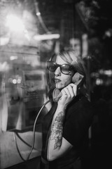 young woman in a phone booth