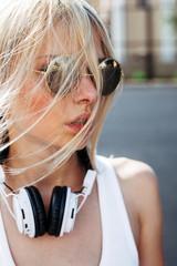 Young blonde woman closeup portrait