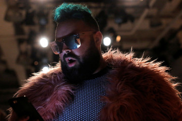 Plus size male model Troy Solomon attends the Addition Elle Spring/Summer 2018 presentation at New York Fashion Week in Manhattan, New York.