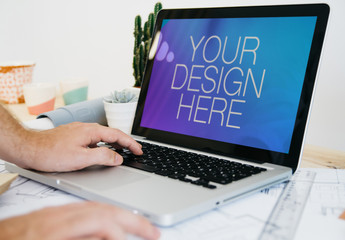 User with Laptop at Desk Mockup 3