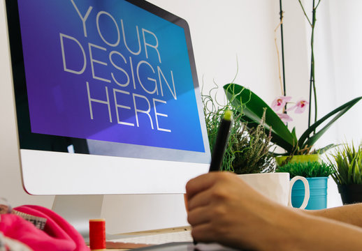 User at Desktop Computer with Drawing Tablet and sewing supplies Mockup 1
