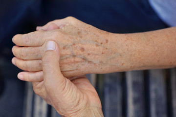 Elderly couple holding hands. Love, tenderness, togetherness, trust, support concept.