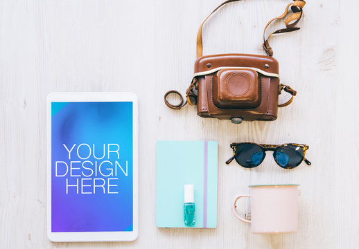 Tablet with Camera and Travel Accessories Mockup 1