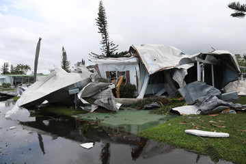 Property damage is seen at a mobile home park after the passing of Hurricane Irma in Naples, Florida