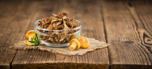 Wooden table with Dried Chanterelles, selective focus