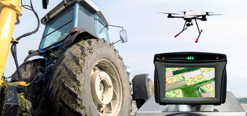 Smart agriculture , farm , precision farming concept. Automation Drone , tractor , NIR images processing application screen device create field health maps for normalize difference vegetation index.