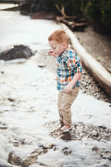 Redhead Boy at the Ocean Standing in the Water