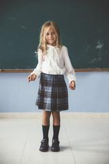 Cute girl at blackboard