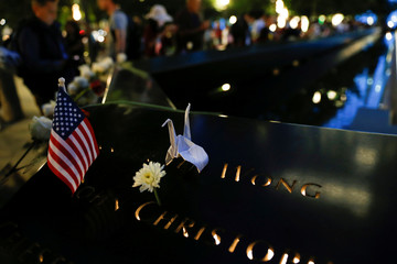 An origami crane rests over a name at the south reflecting pool at the National September 11 Memorial and Museum in lower Manhattan on the 16th anniversary of the 9/11 attacks in New York City