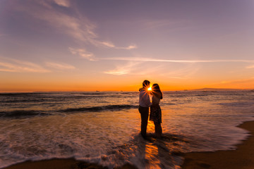 Silhouetted couple at Huntington Beach