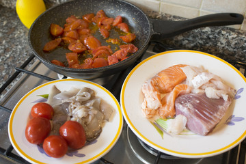 seafood sauce with fresh tomatoes and mixed fish