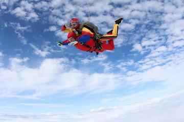 Tandem skydiving. Tandem jump.