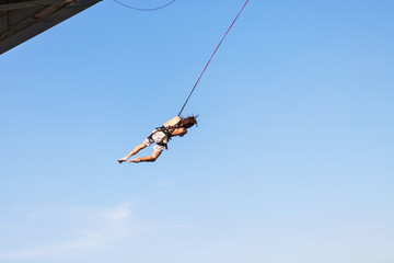 Rope Jumping: people in flight from a height.