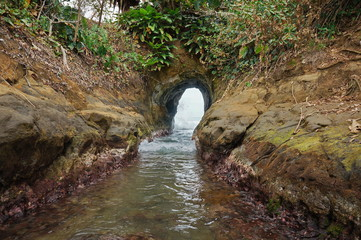 Natural tunnel dug by sea waves, Punta Uva, Limon, Caribbean coast of Costa Rica, Central America