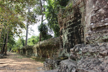 Ruins and walls of an ancient city in Angkor complex, near the ancient capital of Cambodia - Siem Reap