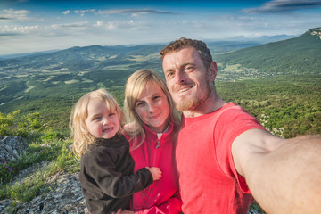 Family hikers making selfie mountain valley background