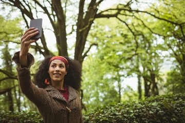 Woman taking selfie at forest