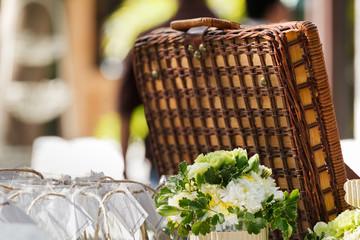 Close up detail of wedding decoration display with vintage travelling bag , flower under sunlight  chrysanthemum