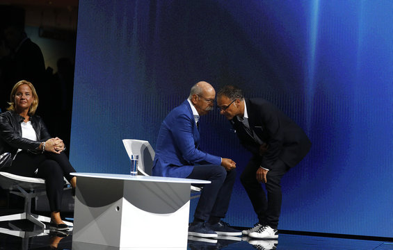 Zetsche, CEO of Mercedes car maker Daimler AG, speaks to a technician who was helping to push the new Smart concept autonomous car Vision EQ fortwo model off stage during the Frankfurt Motor Show (IAA) in Frankfurt