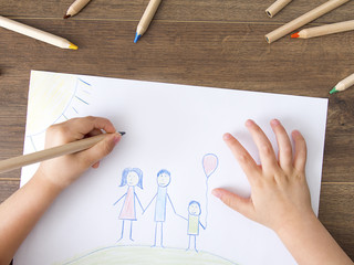 Kid drawing a happy family