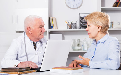 Woman on consultation with doctor