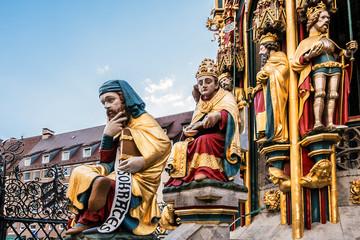 Detail of Beautiful fountain (Schoner Brunnen) and statue. 19 meters high Schoner Brunnen - 14th-century fountain located on Nuremberg's main market, built by Heinrich Beheim. Nuremberg, Germany.
