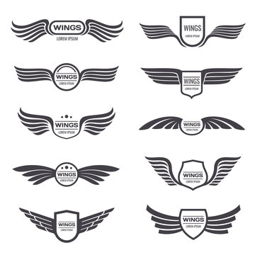 Flying eagle wings vector logos set. Vintage winged emblems and labels