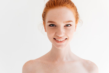 Close up portrait of happy naked ginger woman