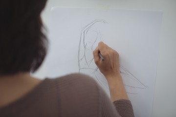 Artist drawing sketch on canvas