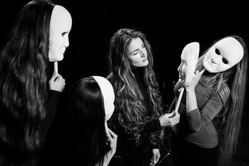 Theater of the mask. Girls and masks. Emotions. Portrait on the stage of the theater.