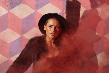 Stylish model posing in red smoke