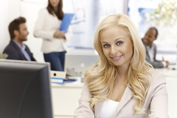 Portrait of young businesswoman smiling