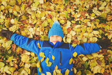happy teenage boy play in autumn fall