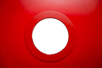 round white porthole in the red door.Copy space