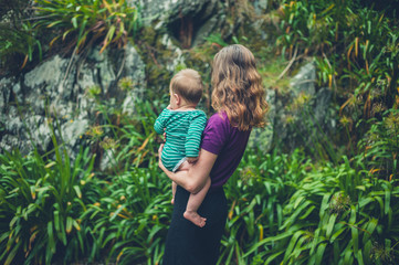 Mother holding baby in nature
